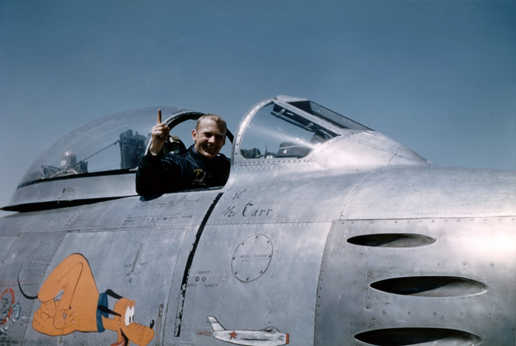 Lieutenant Buzz Aldrin, 51st Fighter Interceptor Wing, in the cockpit of a North American Aviation F-86E Sabre after shooting down an enemy MiG-15 during the Korean War - USAF