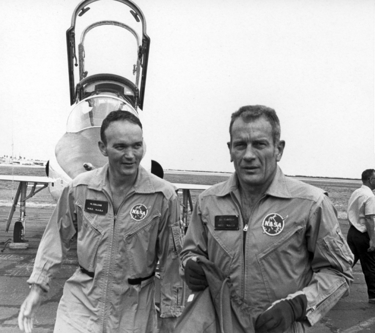 Michael Collins (L) and fellow astronaut Deke Slayton with a NASA T-38. It was on one such flight, from Houston to The Cape and just prior to Apollo 11 that Slayton, the astronauts' boss, asked Collins if he would like to be assigned to a further mission, one that would probably have seen him walk on the moon, but Collins declined, having already decided to spend more time with his family. Collins did however tell Slayton that he would be banging on his door to secure a second attempt if Apollo 11 did not succeed - NASA