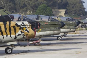 The retired 336 Mira Tiger marked A-7E heads a line of retired aircraft © Tom Gibbons - Global Aviation Resource