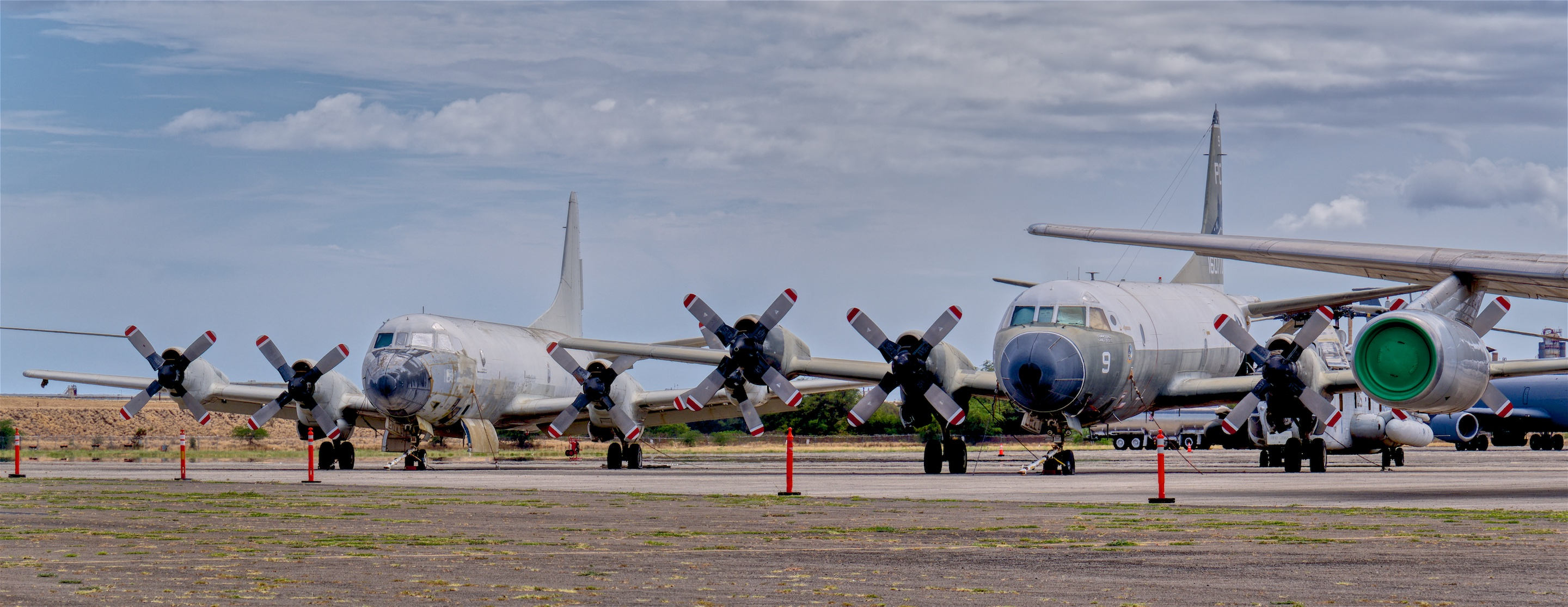 Museum flightline includes these two Lockheed Orions, a UP-3A (left) and P-3C (right) © Hayman Tam - Global Aviation Resource