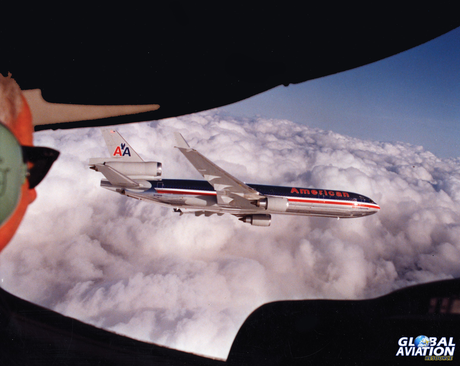 American MD-11 banks away from the photo ship- Clay Lacy Collection