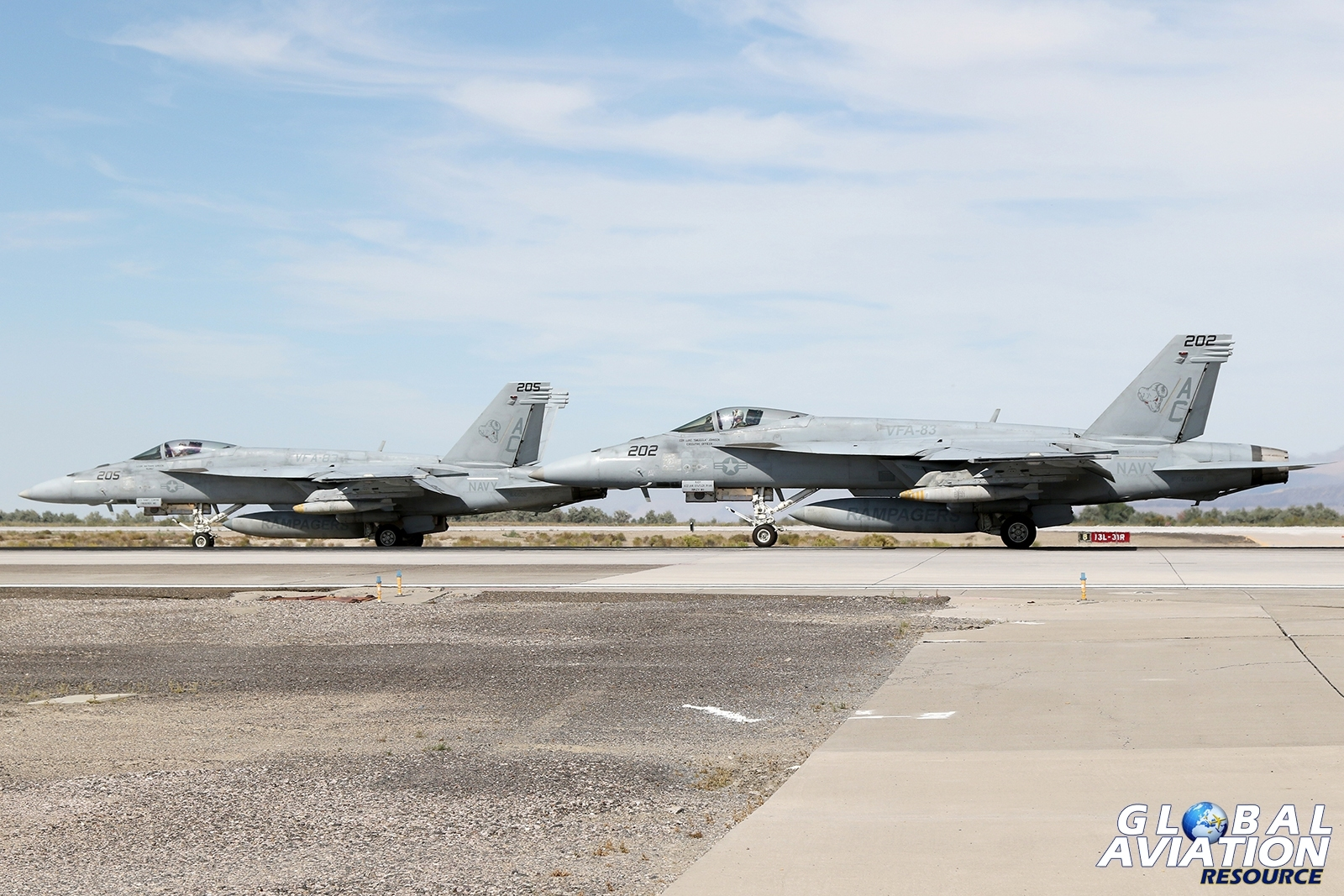 A pair of F/A-18E Super Hornets from VFA-83 on the runway at Fallon © Paul Dunn - Global Aviation Resource