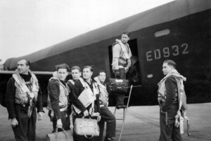 Leader of the Dambusters Raid, Wing Commander Guy Gibson, seen with his crew as they board their Avro Lancaster III ED932/AJ-G for the Dams\' Raid of 16/17 May 1943. L-R: Flight Lieutenant RD Trevor-Roper, Sergeant J Pulford, Flight Sergeant GA Deering (Canadian), Pilot Officer FM Spafford (Australian), Flight Lieutenant REG Hutchison, Wing Commander Guy Gibson, Pilot Officer HT Taerum (Canadian) © Crown Copyright