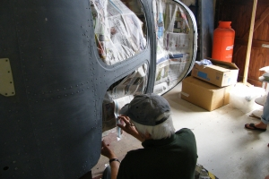 Andy Stewart masks up the fuselage nose section for spray painting, August, 2014.  © Bob Wealthy