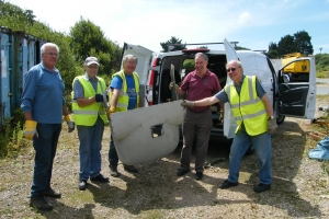 "Finally the last of the multitude of component parts of ""Charlie November"" is loaded up. Left to right – Bob Wilson, Peter Gatrell, Tim Barton, Norman Hobbs and John Kenyon, July, 2010.  © Bob Wealthy"