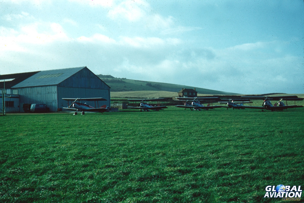 Some of Crop Culture's Tiger Moth crop spraying fleet lined up at Bembridge Airport in the mid 1950s. © Peter Gatrell