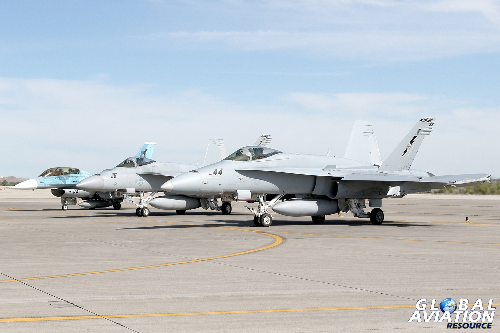 A line-up of NAWDC assigned aircraft holding prior to departure, including an F-16B, F/A-18E and F/A-18C © Paul Dunn - Global Aviation Resource